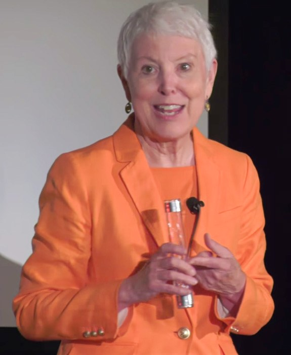 Patsie McCandless speaking with her light stick at TEDx Wilmington